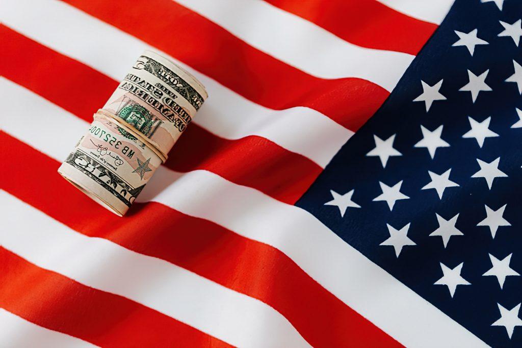 US Flag and Dollar Bill